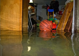 A flooded basement bedroom in